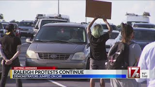 Woman who fought protester who jumped on car asks why Raleigh police didn't help sooner