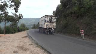 preview picture of video 'Burundi, local cyclists use an original but enormous risky hitchhike'