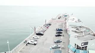 Drone video flying over the Santa Cruz Beach Boardwalk, The Wharf and West Cliff I Santa Cruz, Calif