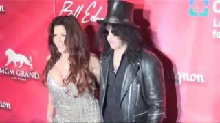 Slash and boxum bombshell wife on the ALI celebration gala red carpet las vegas 2012