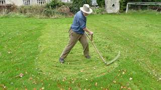 Autumn mowing lawns and meadows with a scythe
