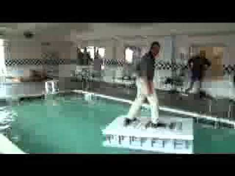 Fox Blocks Sales guy jumps on forms in a pool to see if he can surf them