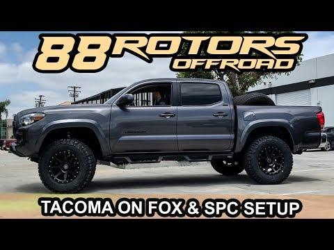 Cavalry Blue Tacoma On Fox Suspension & Enkei RPT1