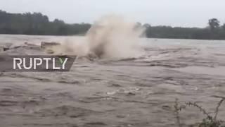 USA:FloodsripdownbridgeinTexas