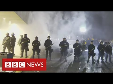 Minneapolis protests over shooting of black man as officer and police chief resign - BBC News