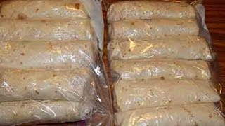 Making freezer breakfast burritos to save time for meals
