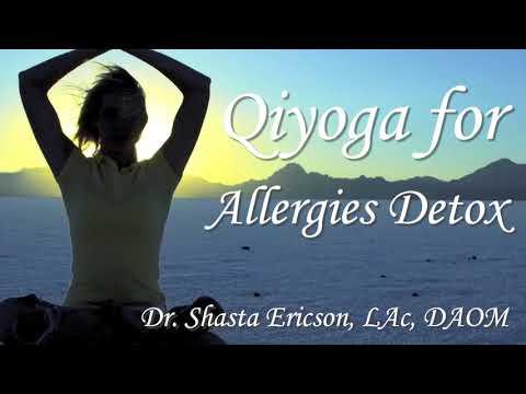 3 women standing on black yoga mats working on allergy/neck pain exercise