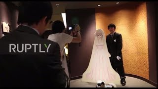 """Group of Men """"Marry"""" Anime Characters in a VR Wedding Ceremony"""