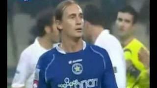 Footballer gets red card for tackling pitch invader