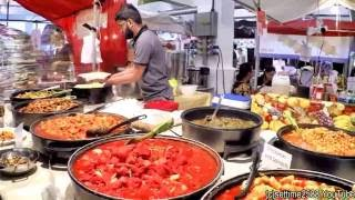 London. A Walk Trough The Street Food Stalls and the Vintage Shops of Brick Lane