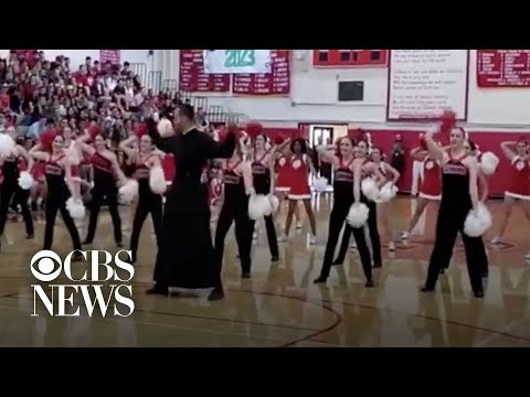Dancing priest joins Catholic school pep rally