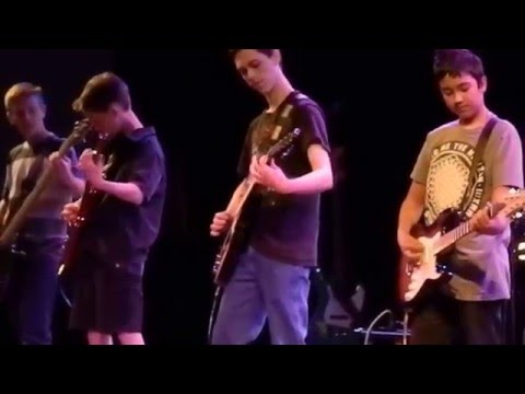 Another group of students and I performing Enter Sandman by Metallica at one of my recitals.