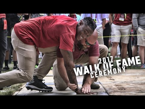 Jonathan Allen, Reuben Foster, Eddie Jackson, and Cam Robinson cement their prints in Bama History