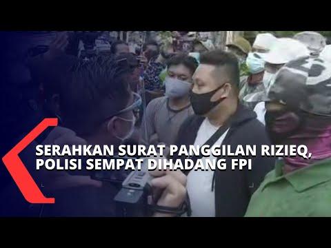 polisi sempat dihadang fpi saat menyerahkan surat panggilan pemeriksaan untuk rizieq shihab