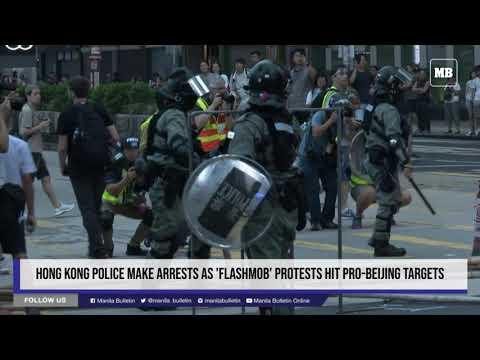 Hong Kong police make arrests as 'flashmob' protests hit pro-Beijing targets