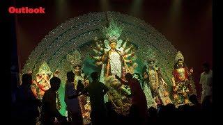 Devotees perform prayer during Durga Puja in Bengal