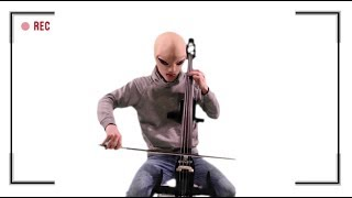 An alien playing Cello by GRAViiTY