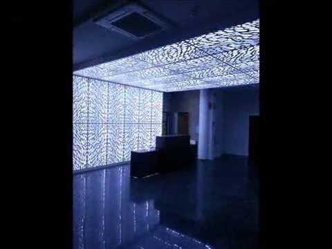 Forrado retroiluminado con luces de LED de pared y techo realizado por Carpintería José Rutia S.L.
