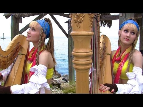 Blonde Twins Playing Final Fantasy Music While Standing Next To A Lighthouse