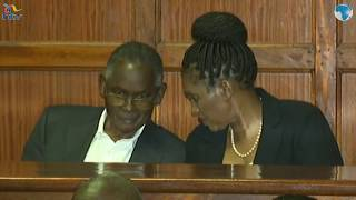The Karanja's share a light moment at the Milimani court