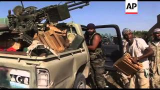 Anti Gadhafi forces secure key ammunition dump