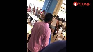 Two women shout and exchange blows in fight at Tekka Centre