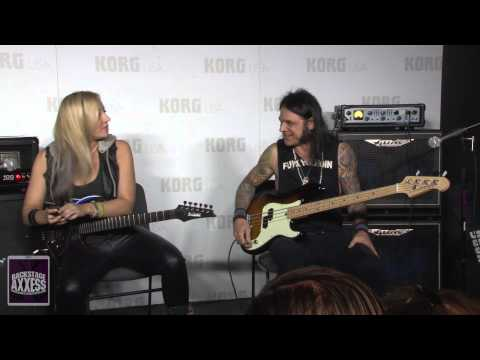 Chuck Garric and Nita Strauss at the Korg Booth at the 2015 NAMM expo.