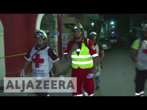 Mexico rescuers find earthquake survivors under school rubble