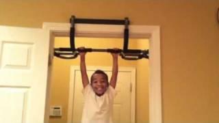 Jude doing pull-ups.