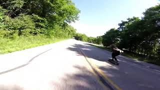 Downhill skateboard chased by fpv drone