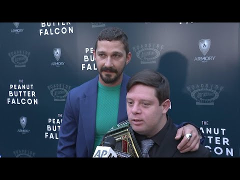 "At the Los Angeles premiere of ""The Peanut Butter Falcon,"" Shia LaBeouf and Zack Gottsagen discuss their friendship, while Dakota Johnson celebrates their connection. (Aug. 2)"