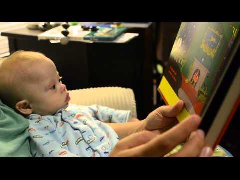 Ver vídeoDown Syndrome: Mom reading Noah