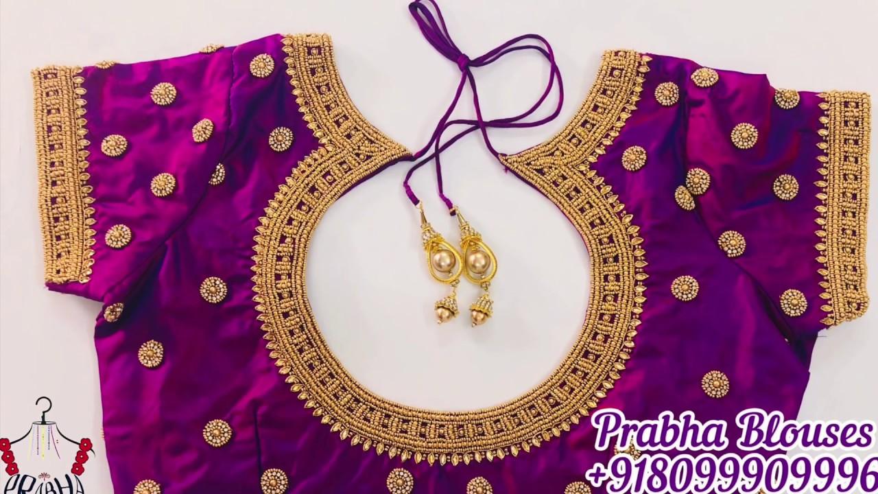 "<p style=""color: red"">Video : </p>Purple Pot Neck Blouse Design | Prabha Blouses | Maggam Work | Aari Work<br>Beautiful Bridal Blouses From Prabha Blouses We Are Specialized In Bridal Blouses Designer Blouses  Work Blouses  Maggam work Blouses at very ..."