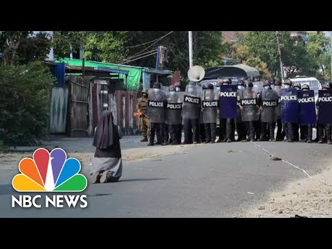 Myanmar Nun Stands Between Police and Protesters | NBC News