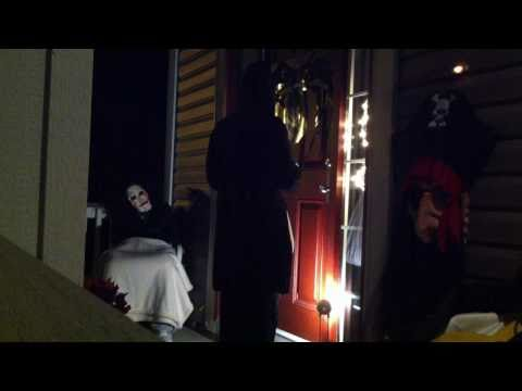 HAHAHAHA!!! We set up the hidden camera to scare trick or treater's and get their reaction.  My brother (in the saw mask) gets decked!!   HAHA - FAIL!!!!!