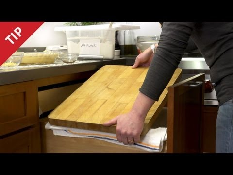 Place A Cutting Board On An Open Kitchen Drawer To Instantly Add Counter Space