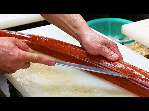 Japanese street vendor breaks down a red cornet fish [29:31]