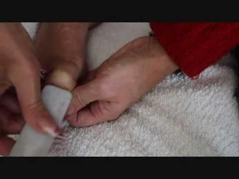 Las revocaciones la seta de té contra el hongo de las uñas