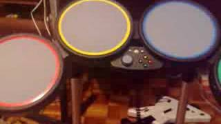 Rock band drum set played in a pc