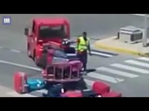 , title : 'Grumpy baggage handler throws suitcases around at Ibiza airport'