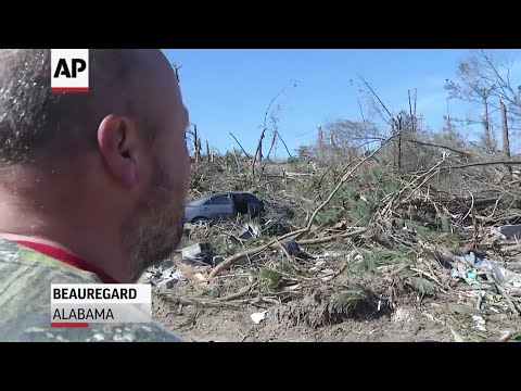Bobby Kidd struggles to look through the debris where his 6-year-old grandson was pulled from his father's arms and killed during a tornado in Beauregard, Alabama on Sunday. (March 7)