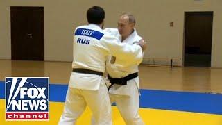 Putin trains with Russian judo champions