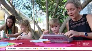 Kindergarten students making loving cards for nursing home residents during coronavirus quarantine