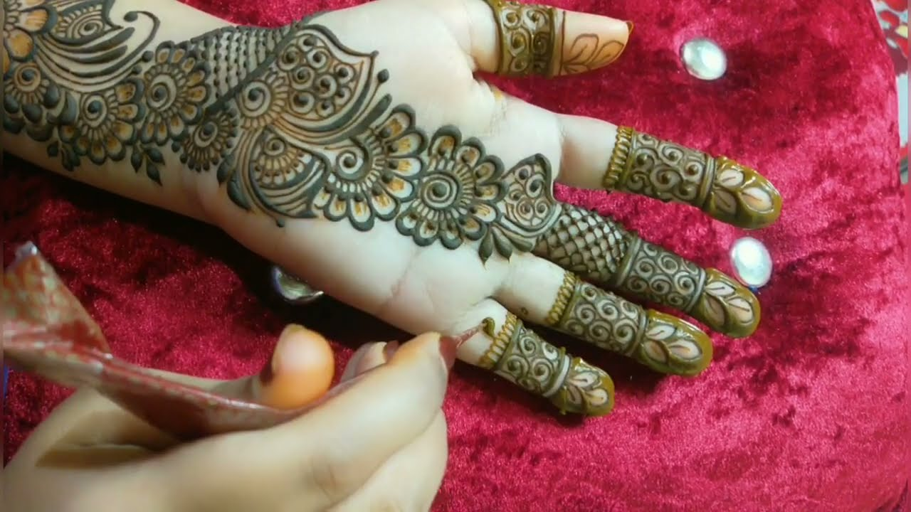 floral arabic mehndi design for front hand by tais mehndi designs