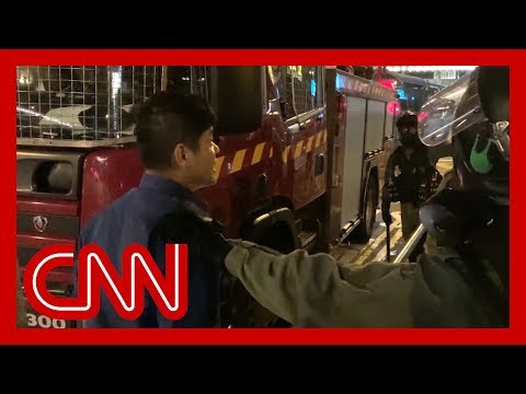 Hong Kong firefighters get caught up in clashes