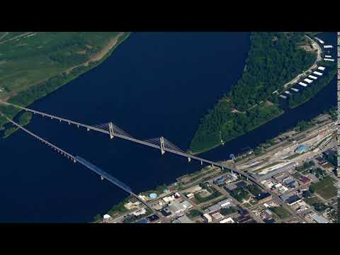 aerial quincy illinois bridge airplane flying wide shot circle shot sqxtkiqk  D