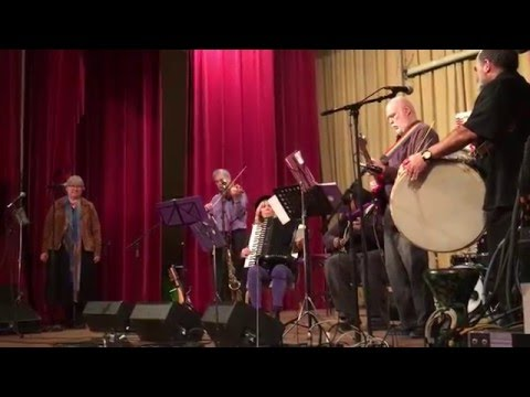 Balkan band performs a dance tune I wrote; I play bass.
