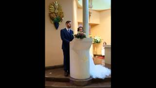 Bride sings to her new husband at wedding.