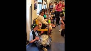Steeldrum player in the Bangkok skytrain
