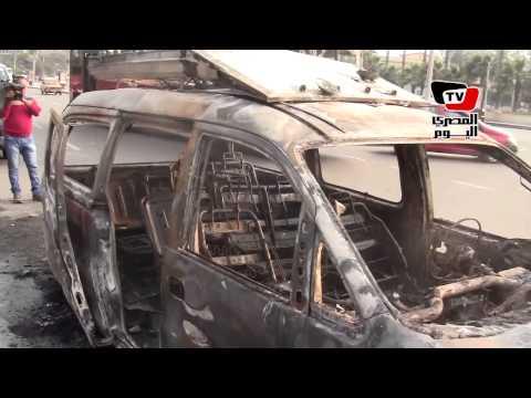 شهود عيان: متظاهرو جامعة القاهرة أشعلوا النار في سيارة  الـ«سي بي سي»